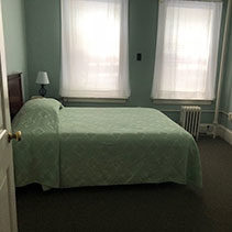 light blue green bed spread on bed at the Coolidge House at Hotel Coolidge